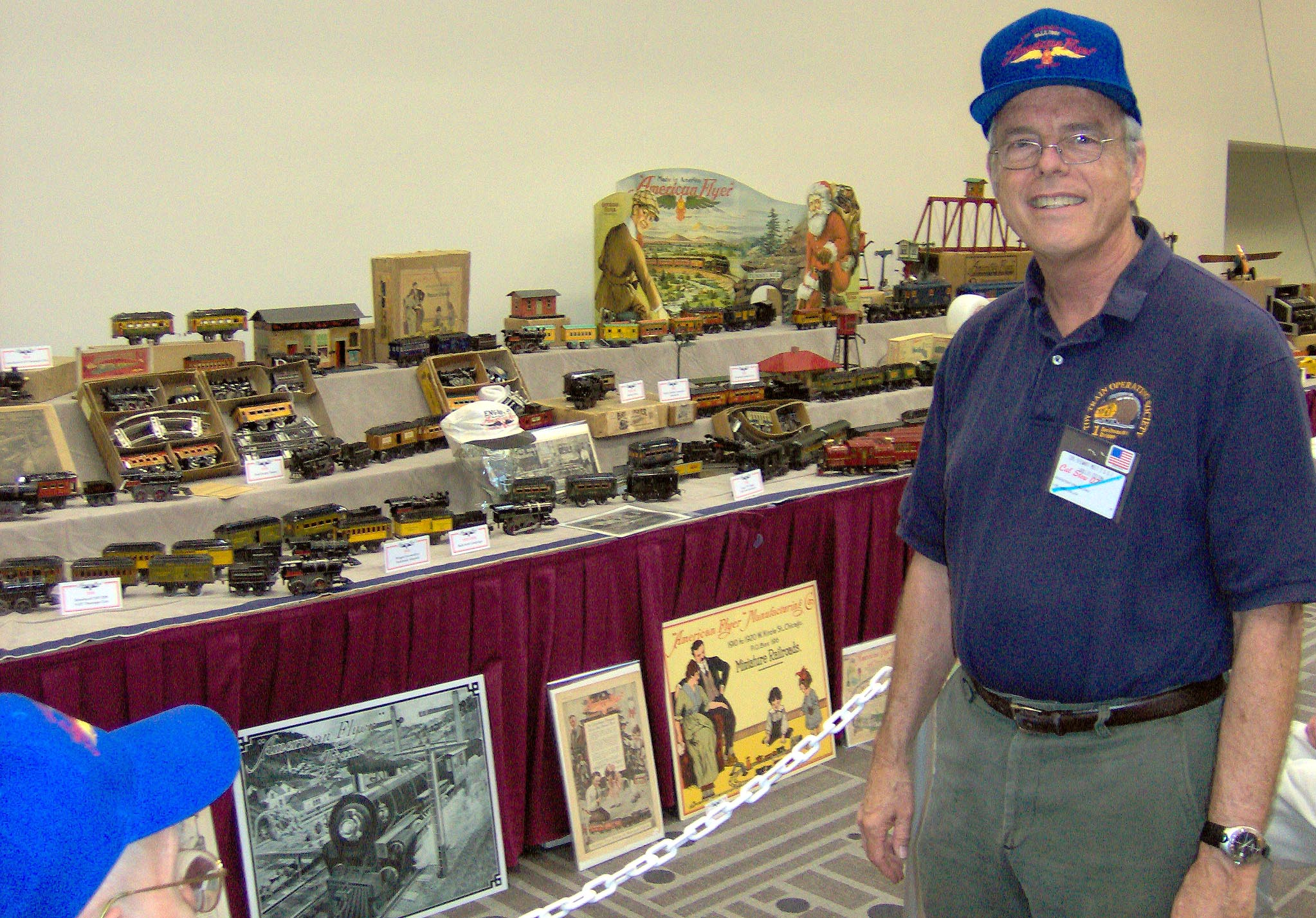 Hollis Cotton stands in front of the exquisite American Flyer Train Display